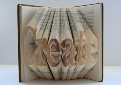 Een boek waarvan de bladeren het woord 'create' vormen
